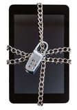 Tablet pc fettered by chain and closed by lock Royalty Free Stock Image