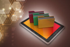 Tablet PC with file folder. In color background Royalty Free Stock Images