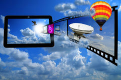Tablet PC with Film strip and Balloon Royalty Free Stock Photos