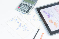 Tablet pc with financial graph Stock Image