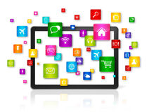 Tablet PC and flying apps icons Stock Photo