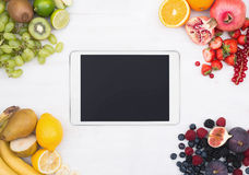 Tablet pc fruit hero header image Royalty Free Stock Image