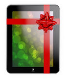 Tablet PC gift. 3d render of tablet PC with red ribbon and bow Royalty Free Illustration