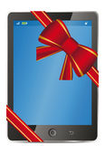 Tablet pc with gift red bow and ribbon Stock Images