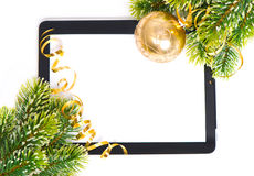 Tablet pc and golden ball and christmas tree Royalty Free Stock Image