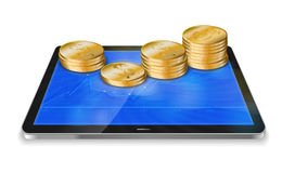 Tablet pc with  golden coin Stock Photo
