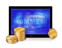 Tablet pc with golden coins Stock Image