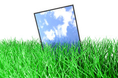 Tablet PC in the Grass Stock Image