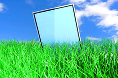 Tablet PC in the Grass Stock Photos