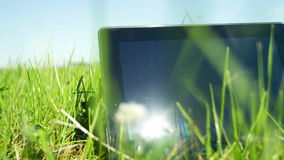 Tablet PC on the Grass stock video