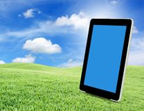 Tablet pc on green grass Stock Image
