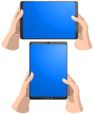 Tablet PC in hands Royalty Free Stock Images