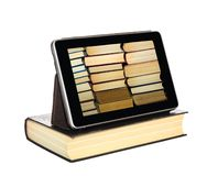 The Tablet-PC is in hard cover book featuring the stack of books on the screen Royalty Free Stock Photography