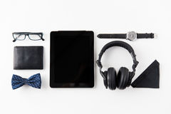 Tablet pc, headphones with hipster personal stuff Stock Image