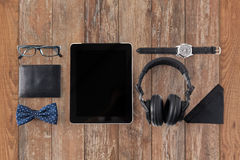 Tablet pc, headphones with hipster personal stuff Royalty Free Stock Image