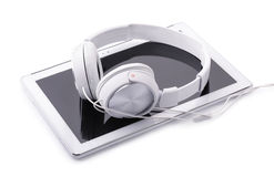 Tablet PC and headphones Royalty Free Stock Image
