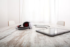 Tablet PC and headphones Stock Image