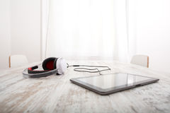 Tablet PC and headphones Royalty Free Stock Images