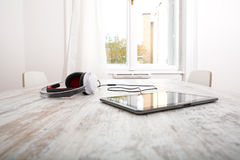 Tablet PC and headphones Stock Images