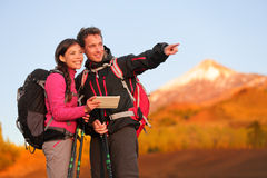 Tablet PC - hiking couple using travel app Stock Photography
