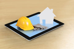 House on tablet Stock Photo