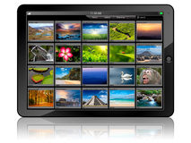 Tablet PC isolated. Tablet PC with photo gallery isolated on white background with reflection Stock Images
