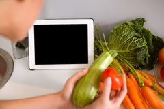 Tablet pc in kitchen Stock Image