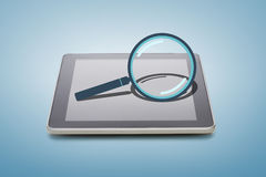 Tablet pc with magnifying glass icon over screen Stock Image