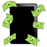 Tablet pc with money Royalty Free Stock Image