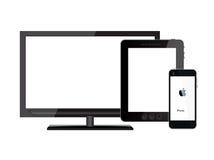 TabletPC:n, mobil ringer och tv:n Arkivbild