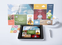 Tablet pc with news application and coffee cup Royalty Free Stock Photo