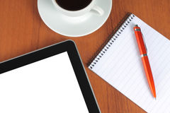 Tablet PC, notepad, pen and cup of coffee Royalty Free Stock Photos