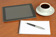 Tablet PC, notepad, pen and cup of coffee Royalty Free Stock Photography