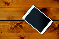 Free Tablet PC On Natural Dark Wooden Table, Top View Stock Photo - 63436370