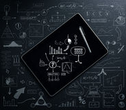 A tablet pc over the black background with elements Royalty Free Stock Photos