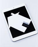 Tablet pc and paper house Royalty Free Stock Photo