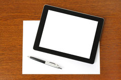 Tablet PC, paper and pen Royalty Free Stock Image