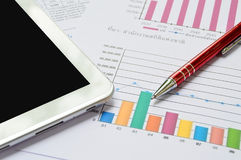 Tablet-pc, papers and pen on table. Tablet-pc, papers and red pen on business table Stock Image