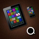Tablet pc phone and coffe cup Stock Image
