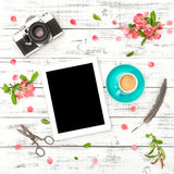 Tablet PC photo camera coffee pink flowers Spring flat lay Stock Images