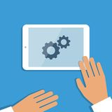 Tablet pc in process and human hands. Vector Stock Image