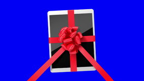 Tablet pc with a red ribbon stock video