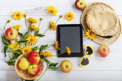 Tablet pc with rustic accessories in light wooden background. Stock Photography