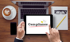 On the tablet pc screen held by businessman hands, Compliance Co Stock Image
