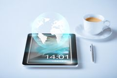 Tablet pc with sign of globe Royalty Free Stock Photography