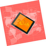 Tablet pc or smart phone on business digital touch screen, world map, happy new year 2016 concept Stock Images