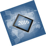Tablet pc or smart phone on business digital touch screen, world map, happy new year 2016 concept Stock Photography
