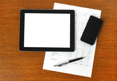 Tablet pc, smart phone and paper with graphs Royalty Free Stock Photo