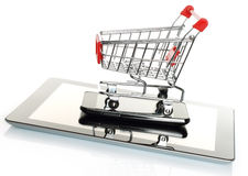 Tablet PC and smart phone with shopping cart Royalty Free Stock Image