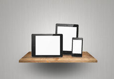 Tablet pc and smart phone on wood shelf Royalty Free Stock Photography